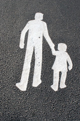 way for parent with child - sign on pavement