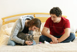 couple with a kitten poster