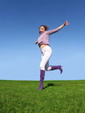 happy woman running on grass poster