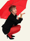 businesswoman with a red umbrella looking up poster