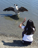 a girl talking to a goose poster
