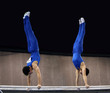 2 gymnasts on parallel bars