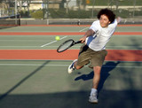 teenage boy playing tennis