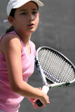 young girl playing tennis poster