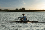 rowing alone at sunset poster