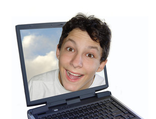 smiling boy getting out of the laptop