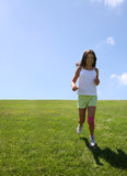 girl running on grass poster