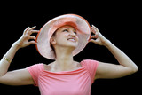 elegant woman in a pink straw hat poster