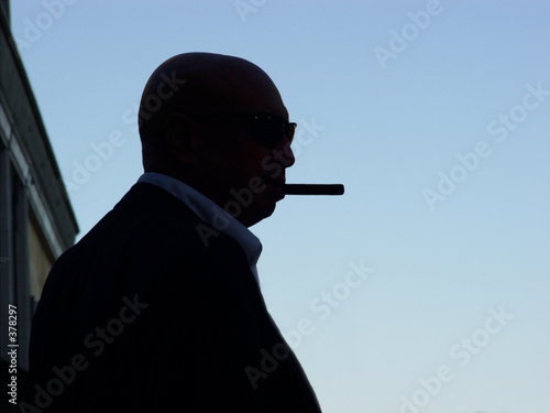 silhouette of a mafia man