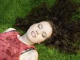 beautiful girl sleeping on the grass poster