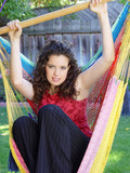 cute girl in a hammock on the backyard poster