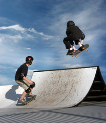 girl and a boy skateboarding