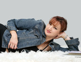 casual woman relaxing on the floor poster