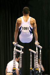 gymnast competing on parallel bars