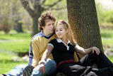 romantic couple sitting in a park. poster