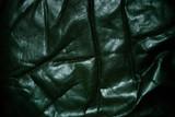 wrinkled old black leather poster