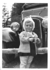 little girl and old car