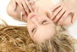 glamorous blonde lying down poster