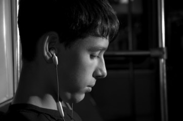 teen with ear-phones