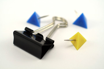 paper clip and thumb tacks