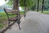 empty bench in the park in skopje poster