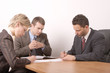 business meeting - 3 people - signing contract - g