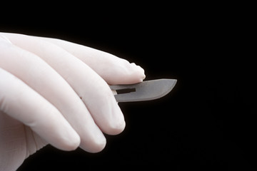 surgeon holding a blade