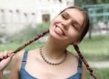 girl with braids smiling poster
