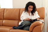 teenage girl reading a magazine on a sofa poster