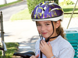 cute girl in a helmet is going for a ride poster
