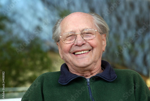 old man laughing on a blurred background - 408082