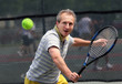 middleage man playing tennis
