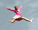 jumping happy girl against the sky poster