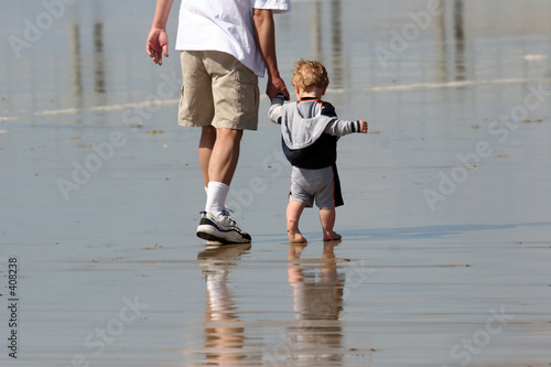 poster of father and son on the beach
