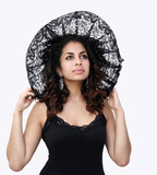 beautiful woman in black lace hat