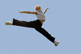 young woman jumping high poster