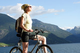attractive woman on the bike in the mountains poster