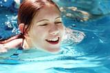 Fototapety happy girl in a pool