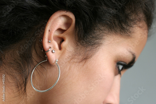 abstract of a girl with pierced ears
