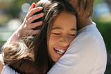 mother hugging her happy daughter poster