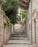 view of a narrow alley in split, croatia poster