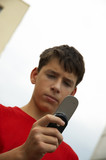 teen with cell-phone outside poster