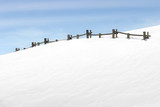 fence on snowy hill poster
