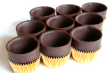 nine chocolate cups