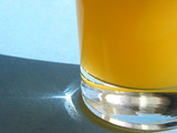 orange juice in a glass poster