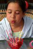 birthday girl blowing out candles poster