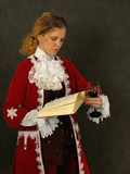 woman in old-fashioned french clothes reading a book poster
