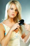 woman brushing hair poster