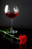 wine glass and a rose poster