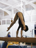 gymnast competing on beam poster